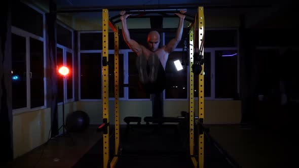 Bodybuilder Doing Intense Abs Workout Late at Night in the Gym