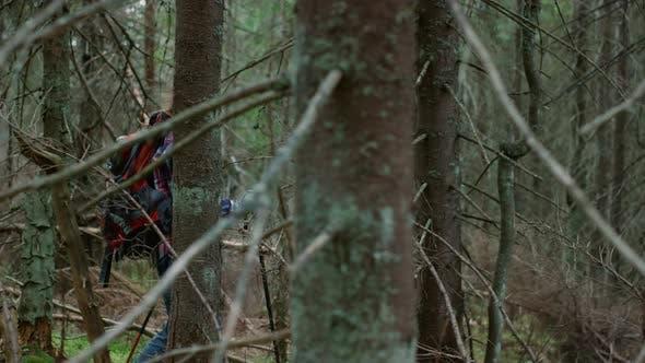 Happy Woman Hiking in Wood