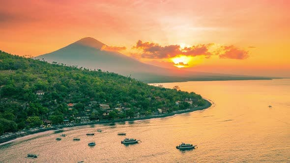 Thumbnail for Top View of Amed, Jemeluk Bay and Volcano Agung at Sunset in Bali, Indonesia. Aerial Timelapse
