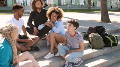 Stylish Multiethnic Friends Chilling on Street