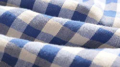 Blue and white shirt chequered   pattern fabric texture slow tilt 4K 2160p 30fps UHD footage - Gigha