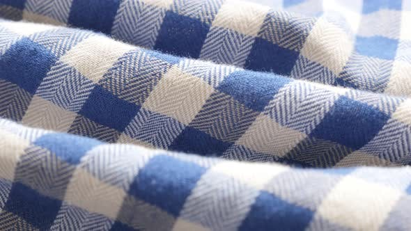 Thumbnail for Blue and white shirt chequered   pattern fabric texture slow tilt 4K 2160p 30fps UHD footage - Gigha