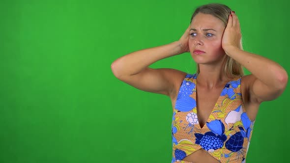 Thumbnail for Young Pretty Blond Woman Is Afraid (Woman Covers His Ears with Hands) - Green Screen - Studio