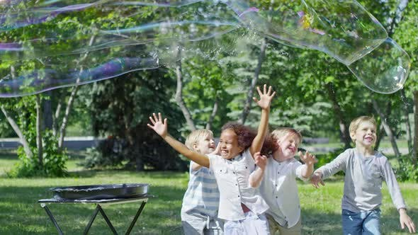 Thumbnail for Performer Launching Huge Soap Bubble for Little Girl and Boys
