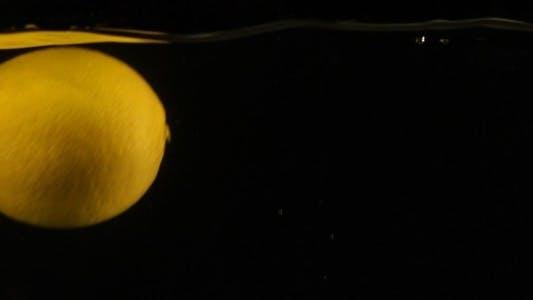Thumbnail for Fresh Lemon Falling in Water Slow Motion