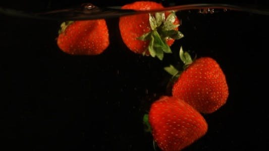 Thumbnail for Fresh Strawberries Falling In Water Slow Motion