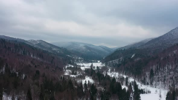 Thumbnail for Drone Flying Above Mountains Covered with Snow