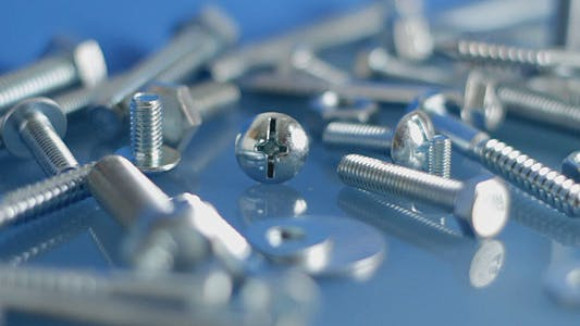 Thumbnail for Rotating Bolts And Nuts On Workbench