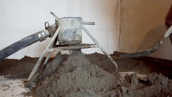 Thumbnail for Builder Throwing Shovel Cement Pouring Concrete on Steel Iron Fence on Floor at Construction Site of