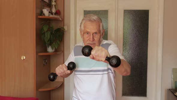 Thumbnail for Senior Elderly Caucasian Man Doing Sports Exercises with Dumbbells at Home