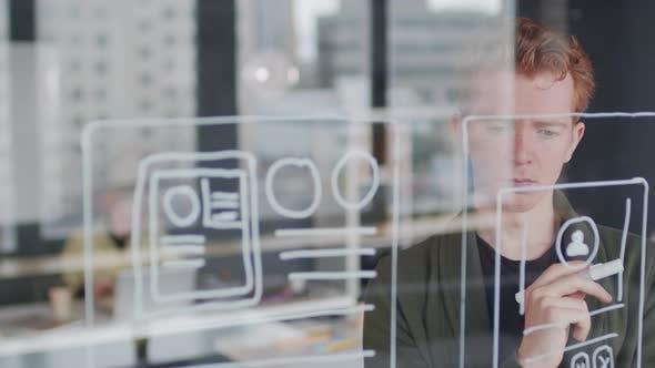 Male UI Designer Thinking about App Interface Idea