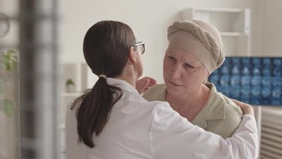 Doctor Supporting Sad Woman with Cancer