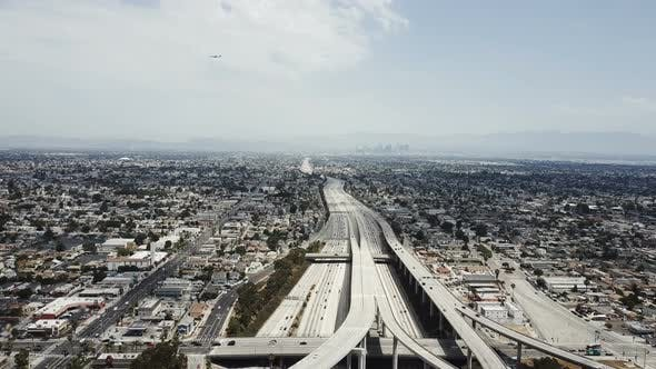 Drone Descending Over Amazing American City Suburbs, Traffic Moving on Large Highway with Amazing