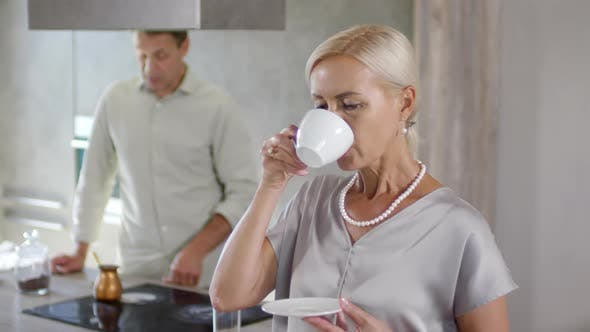 Thumbnail for Wealthy Caucasian Lady Enjoying Morning Coffee at Home