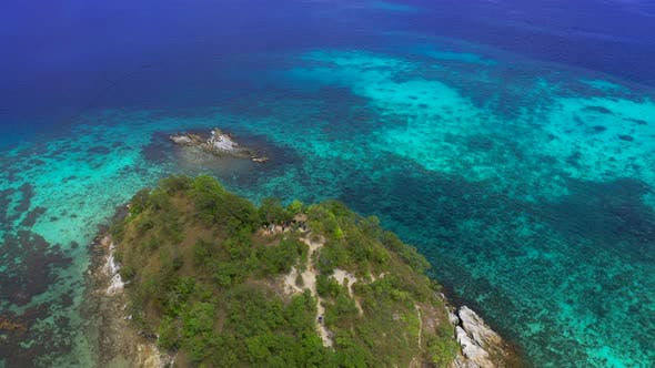 Thumbnail for Turquoise Coastal Waters and Coral Reef in El Nido Archipelago Tourist Destination of Snake Island