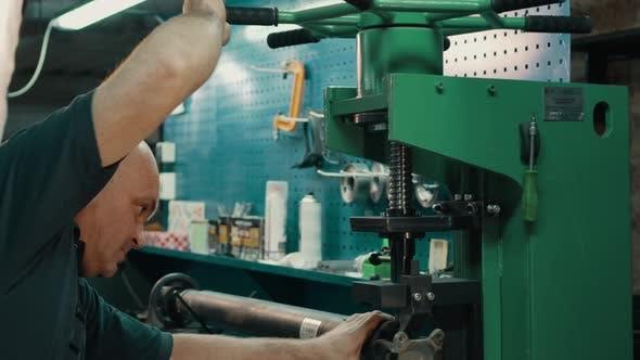 A Locksmith Repairing a Gimbal