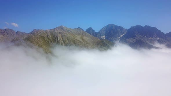 Thumbnail for Peak of Foggy Green Mountains and Cloudscape under Blue Sky