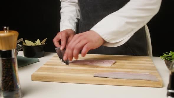 Professional Chef Cutting Raw White Fish Closeup Thin Slices