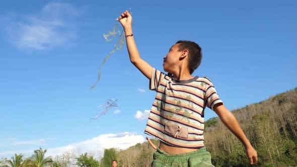 Rural Asian Kids Flying Kite