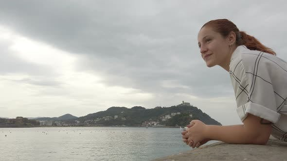 Thumbnail for Young redhead woman looking the views of San Sebastian, Spain