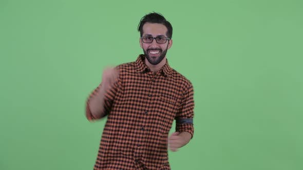 Thumbnail for Happy Young Bearded Persian Hipster Man Dancing