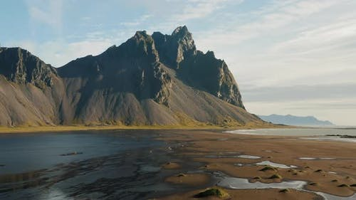 Aerial Drone Footage of Vestrahorn Mountain and Stokksnes Beach in Low Tide