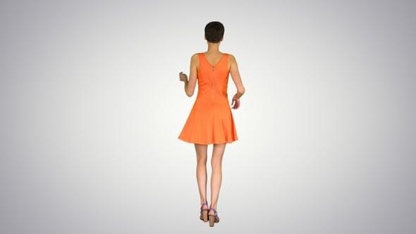 Thumbnail for Girl Dancing in Orange Sun Dress on Gradient Background