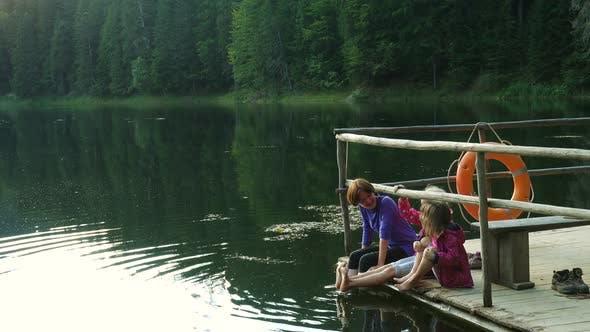 Thumbnail for Children Sitting On A Lake Shore 3