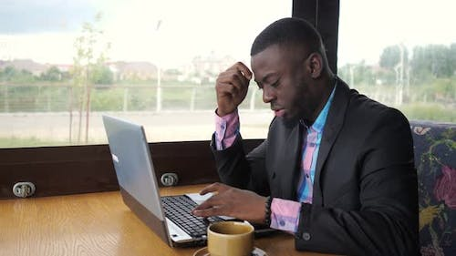 Black Man Works on Laptop but It's Broken and He Nervous and Knocking on Keys
