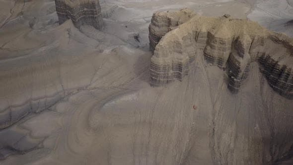 Thumbnail for Aerial view flying over small mesas viewing eroded terrain