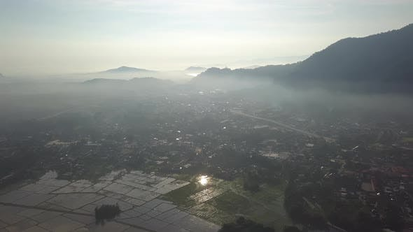 Aerial view misty morning at small town