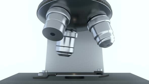 Cover Image for Laboratory Microscope in Bright White Laboratory Rotating its Metal Lenses