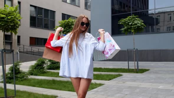 Girl Holding Colorful Shopping Bags, Rejoicing Discounts in Fashion Store, Enjoying Shopping in Mall