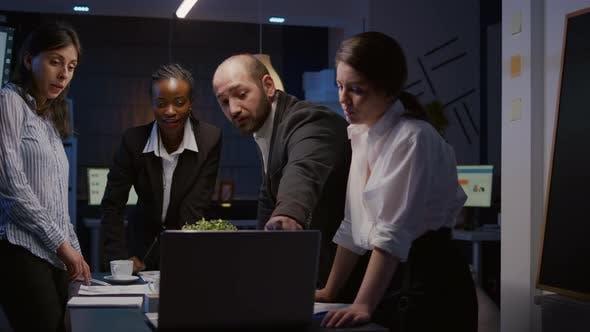 Diverse Teamwork Checking Management Presentation on Laptop Computer