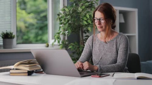 Woman Listening Audiobook at Home
