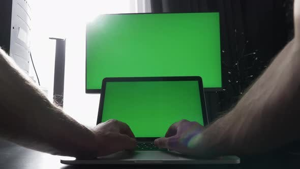 Laptop and monitor with green screen