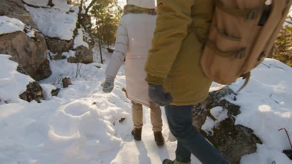 Thumbnail for Friends Walking Down Mountain Slope
