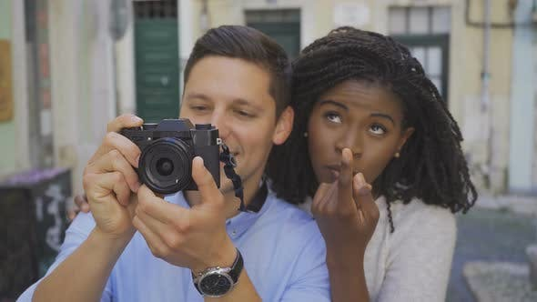 Cover Image for Couple of Tourists Taking Pictures of Sightseeings