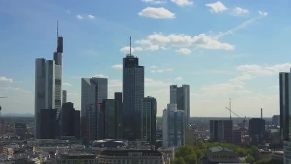 Thumbnail for AERIAL: Flying Towards Beautiful Frankfurt Am Main Skyline with Blue Sky and Sun Shining