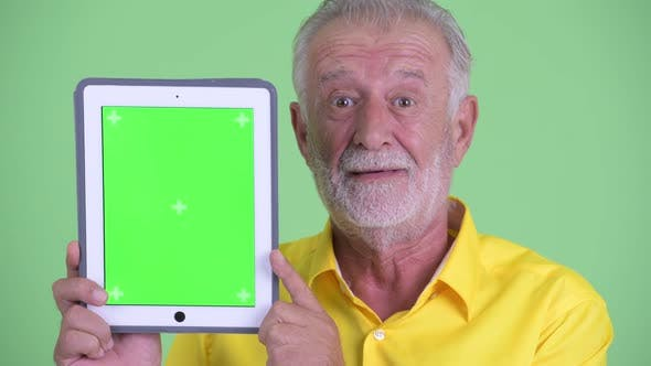 Thumbnail for Face of Happy Senior Bearded Businessman Showing Digital Tablet