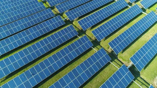 Aerial Top View of Solar Panels Farm (Solar Cell) with Sunlight