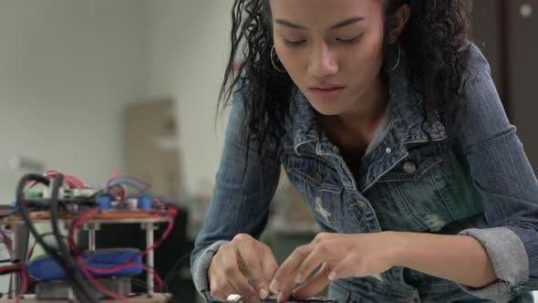 Woman developing electronic