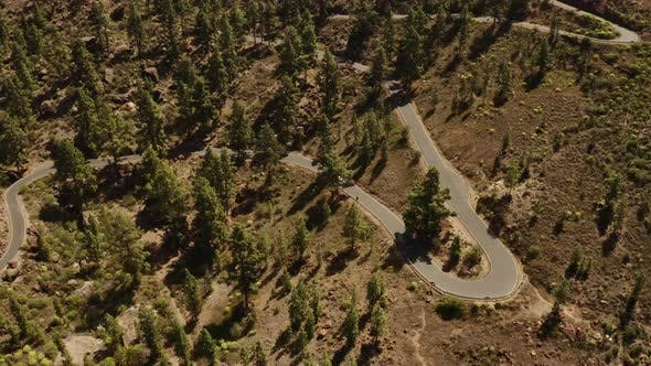 Thumbnail for Aerial Shot of a Car Cruising Through the Road in the Valley