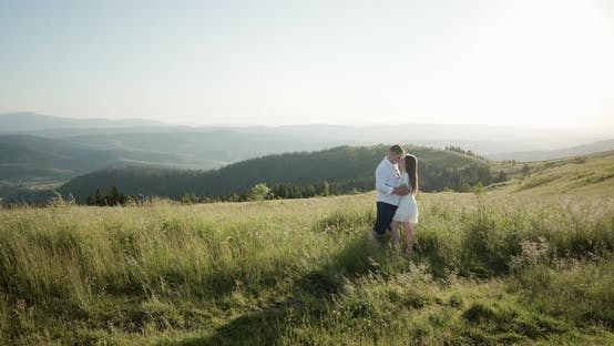 Thumbnail for Young Adorable Couple in the Green Dense Mountain Region