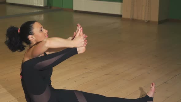 Thumbnail for Gorgeous Woman Doing Yoga Stretching Her Body Indoors
