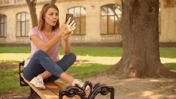 Thumbnail for Young Woman Has Video Call Near College