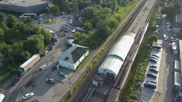 Thumbnail for Flying Over Suburban Railway Station with Arriving Train, Russia