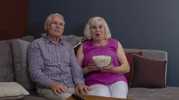 Thumbnail for Overjoyed Old Mature Couple Football Fans Watching Sport Tv Game Support Cheer Winning Soccer Team