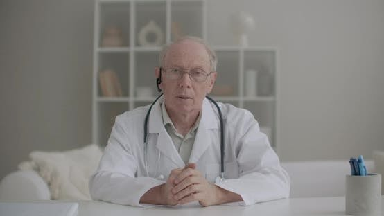 Thumbnail for Portrait of Professor of Medicine, Conducting Webinar From His Office in Clinic, Aged Man Is Looking