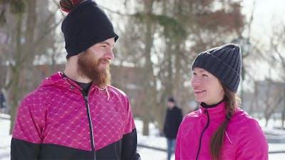 Couple in Sportswear Laughing in Winter